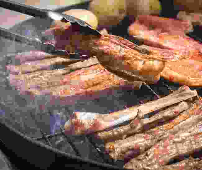 Try a meal cooked on a braai (Dreamstime)