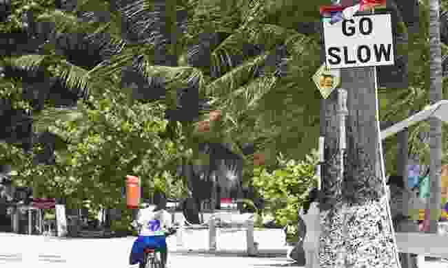 A 'Go Slow' sign in Caye Caulker, Belize (Dreamstime)