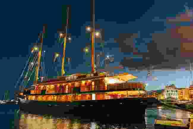 The MV Galileo anchored at night (Peregrine)