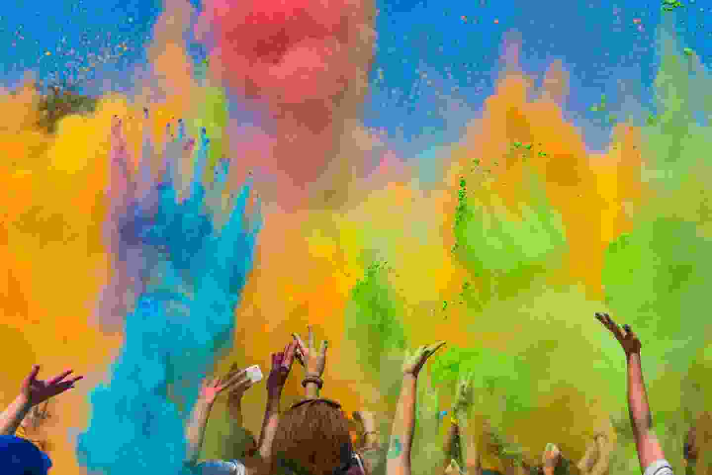 Colours are thrown into the air for Nepal's Holi Festival (Shutterstock)