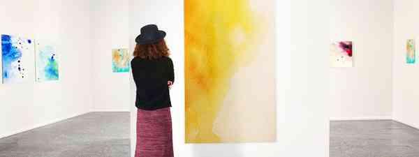Young woman in modern art gallery (Shutterstock)