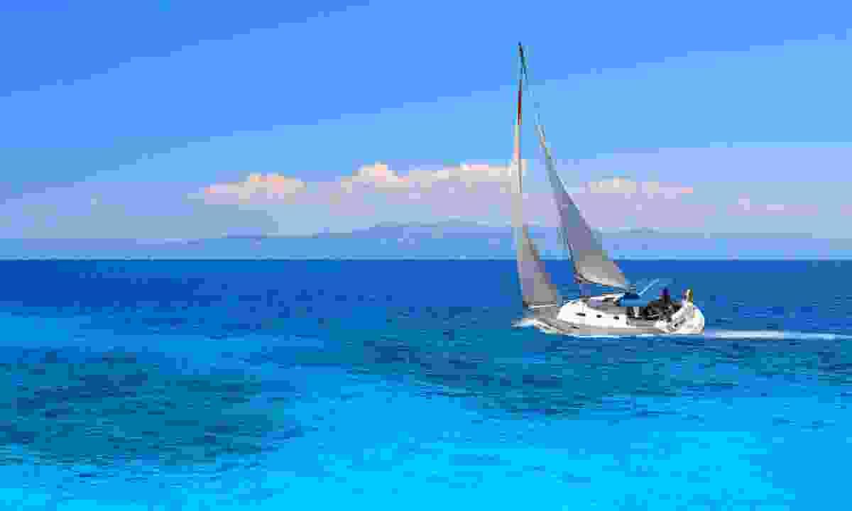 Sailing off Santorini (Dreamstime)