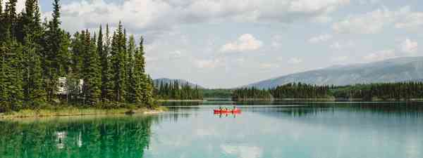 Canoeing on Boya Lake in Boya Lake Provincial Park (Destination BC/Megan McLellan)