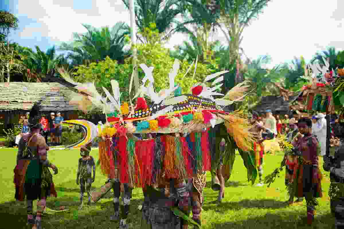 The villagers of Moim perform their fish dance, representing the long journey of their ancestors (Mark Stratton)