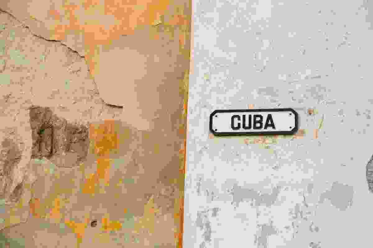 A 'Cuba' street sign on a crumbly street corner wall (Graeme Green)