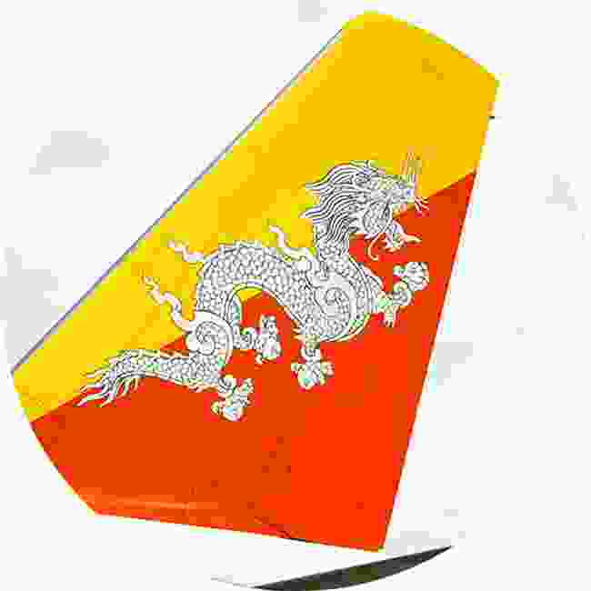Royal Bhutan Airlines features Druk, the Thunder Dragon from Bhutanese mythology. He is holding a jewel to represent wealth (Shutterstock)