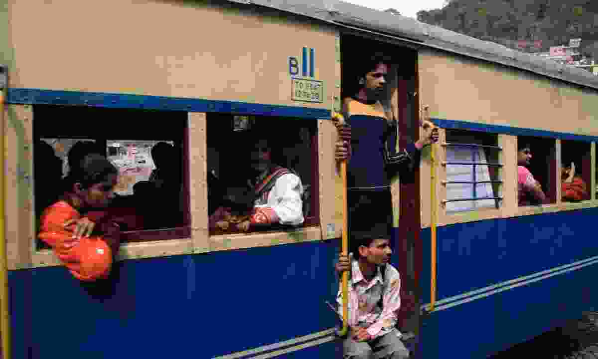 Passengers on the Kalka-Shimla Railway (Dreamstime)