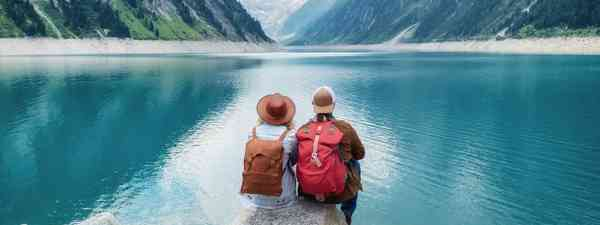 Active couple overlooking a lake (Shutterstock)
