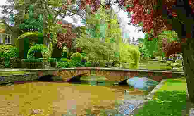 The River Windrush flowing through Bourton-on-the-Water (Shutterstock)