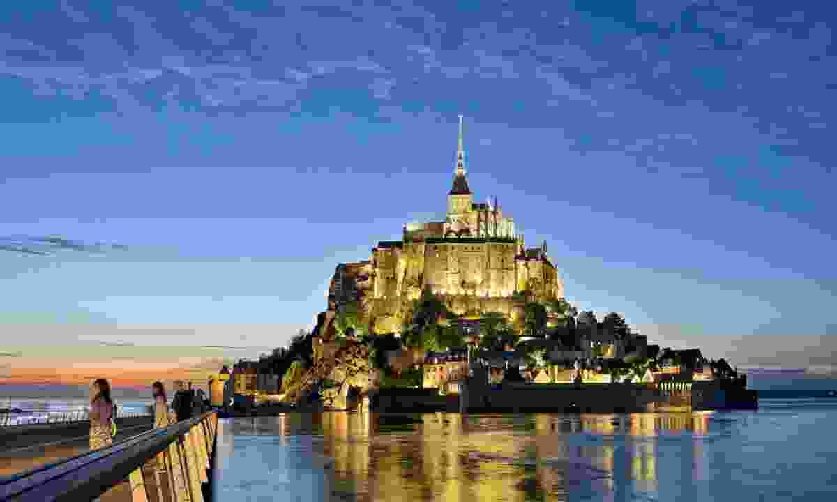 Mont-Saint-Michel lit up at night (Marc Le Rouge)