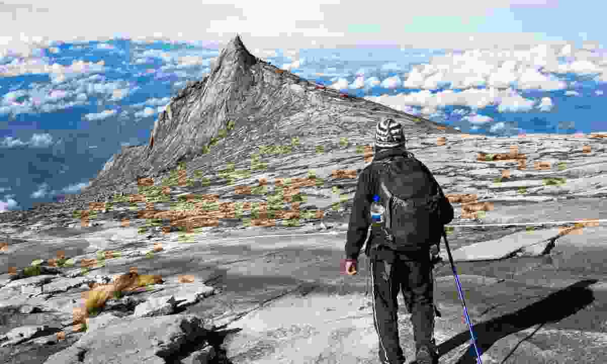 Trekking to the peak of Mount Kinabalu (Dreamstime)