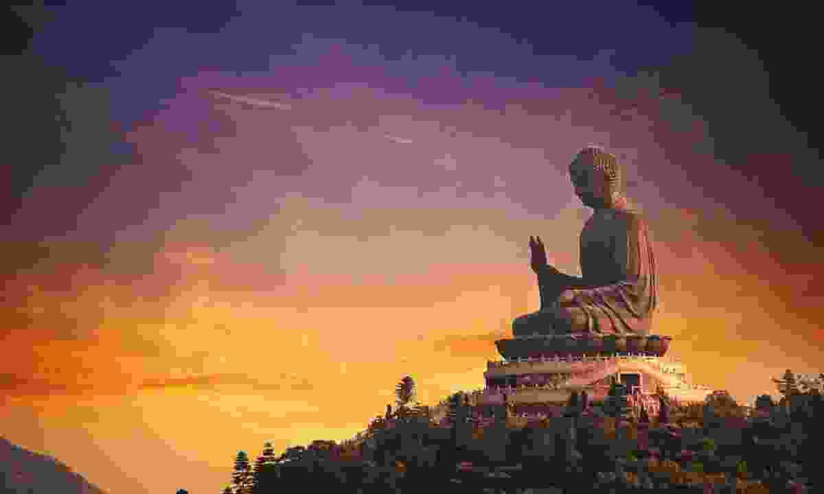 The Tian Tan Big Buddha sits atop Muk Yue Shan (Dreamstime)