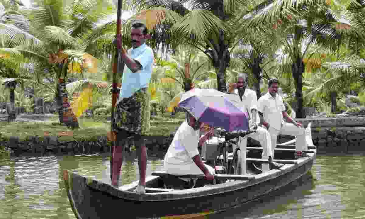 Men travel by boat (Dreamstime)