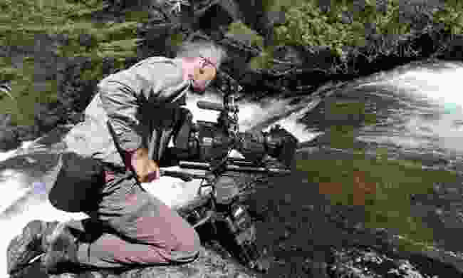 Cameraman Barrie Briton films white water falls in Nahuel Huapi National Park in the Argentinian Andes (Mandi Stark/Silverback/Netflix)