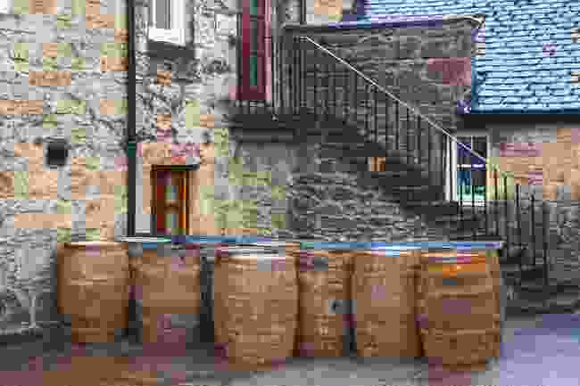 Barrels full of whiskey outside a traditional distillery Dalmore (Shutterstock)