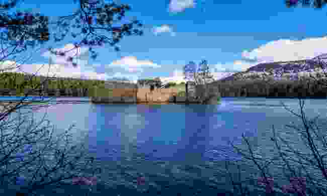 The castle in the middle of Loch an Eilein (Shutterstock)