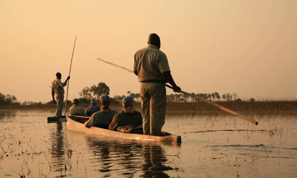 Sailing in traditional mokoro in The Okavango Delta (Shutterstock)