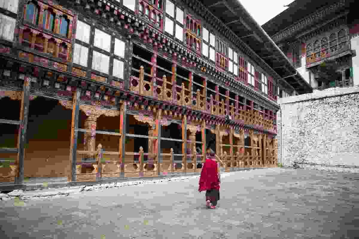 A monk walking through Trongsa Dzong Monastery (Shutterstock)