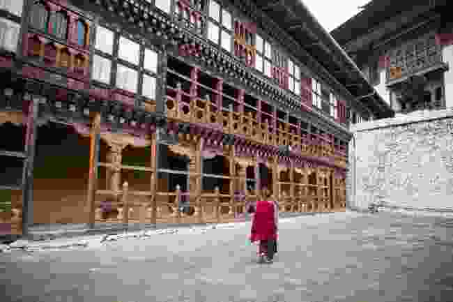 A monk walking through Trongsa Dzong Monastery (Shutterstock)