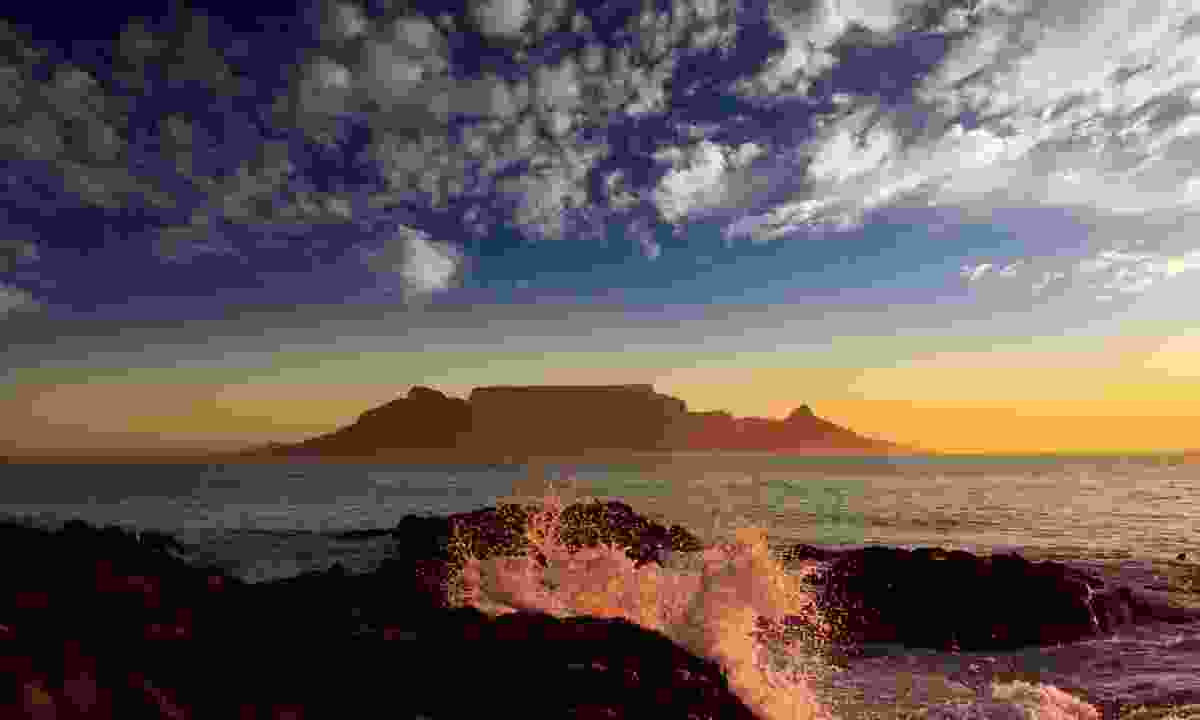View from Bloubergstrand Beach as the sun sets over Table Mountain (Dreamstime)
