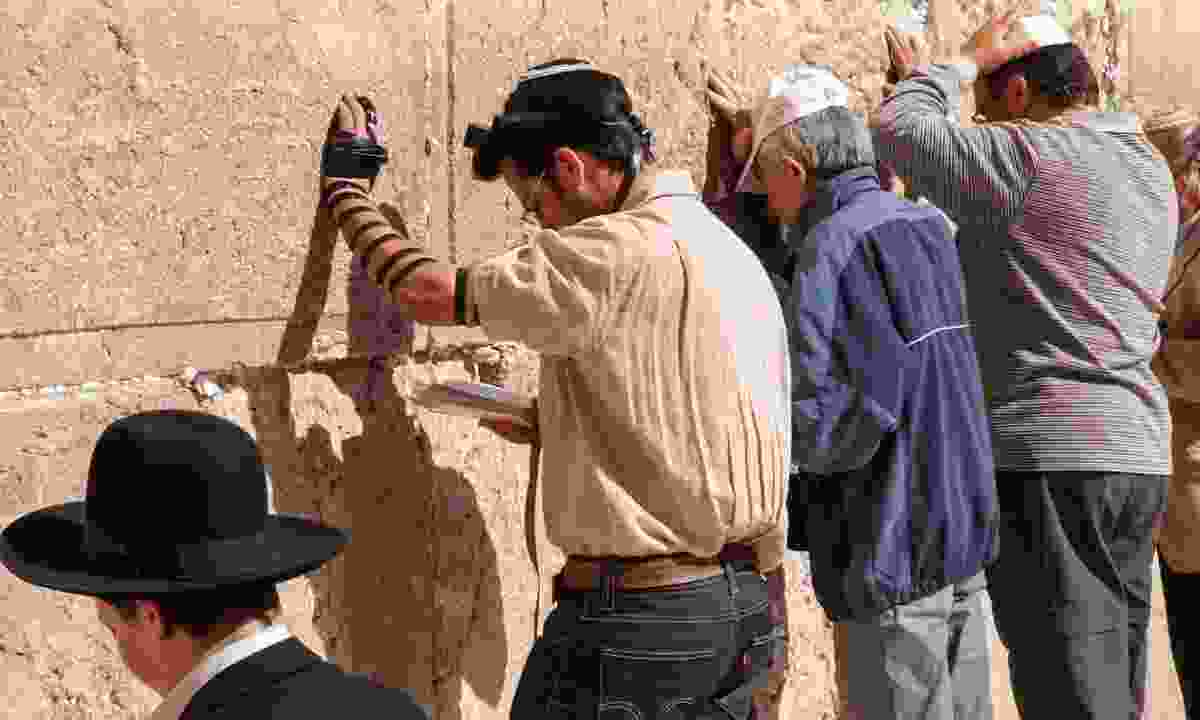Praying at the Western Wall (Dreamstime)