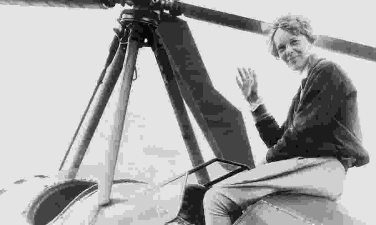 Amelia Earhart waving from her cockpit in 1932 after becoming the first woman to sail across the Atlantic solo (Dreamstime)