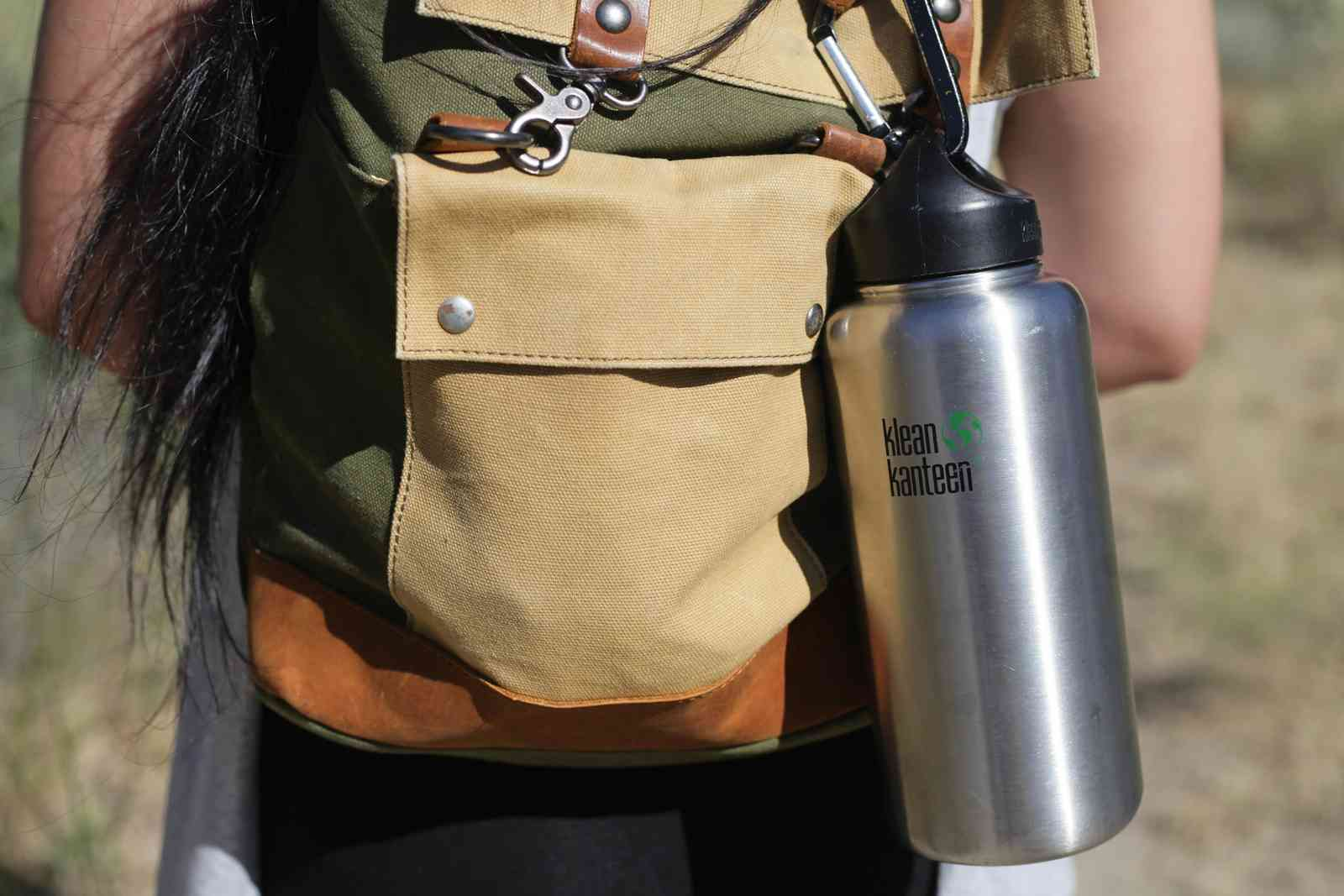 A woman hiking with a water bottle (Shutterstock)