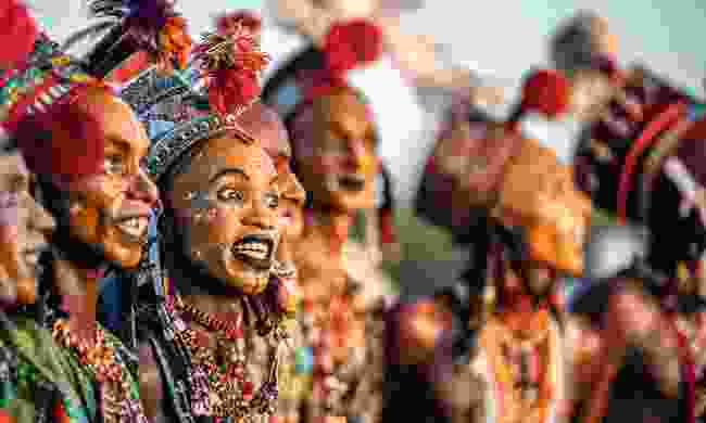 Beauty at the Gerewol is judged by how well the performing men dance as well as the way they dispaly the whiteness of their teeth and eyes (Trevor Cole)