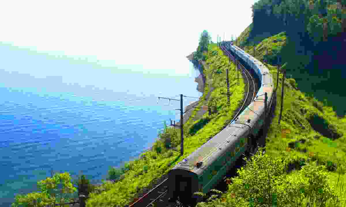 The Trans Siberian following the southern shore of Lake Baikal (Dreamstime)