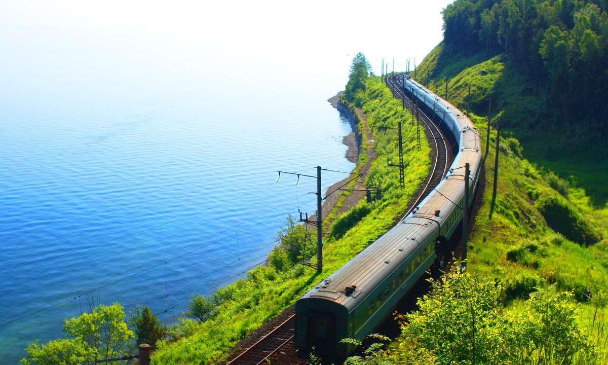 The Trans Siberian following the southern shore of Lake Baikal (Dreamstime)