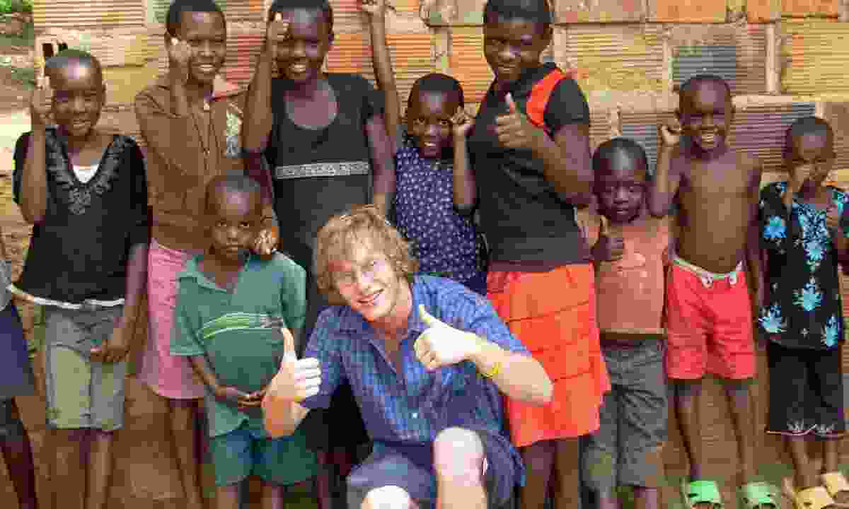 Meeting local kids in Tanzania (Dreamstime)