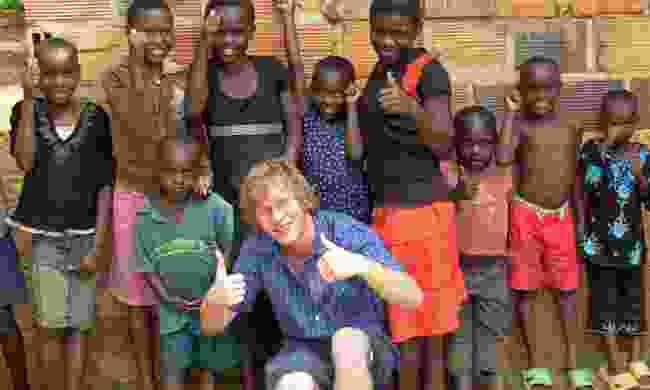 Meeting local kids in Tanzania (Dreamstime)