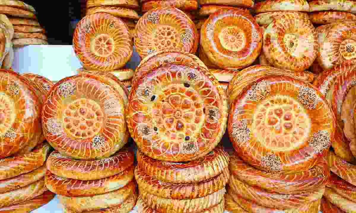 Flat cakes being sold at a market in Bishkek (Dreamstime)