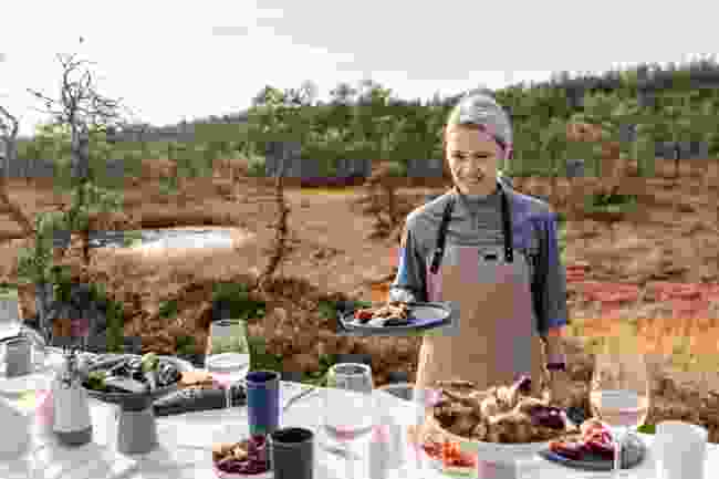 A chef serves a dinner made with foraged ingredients in a bog in Estonia (Renee Altrov)