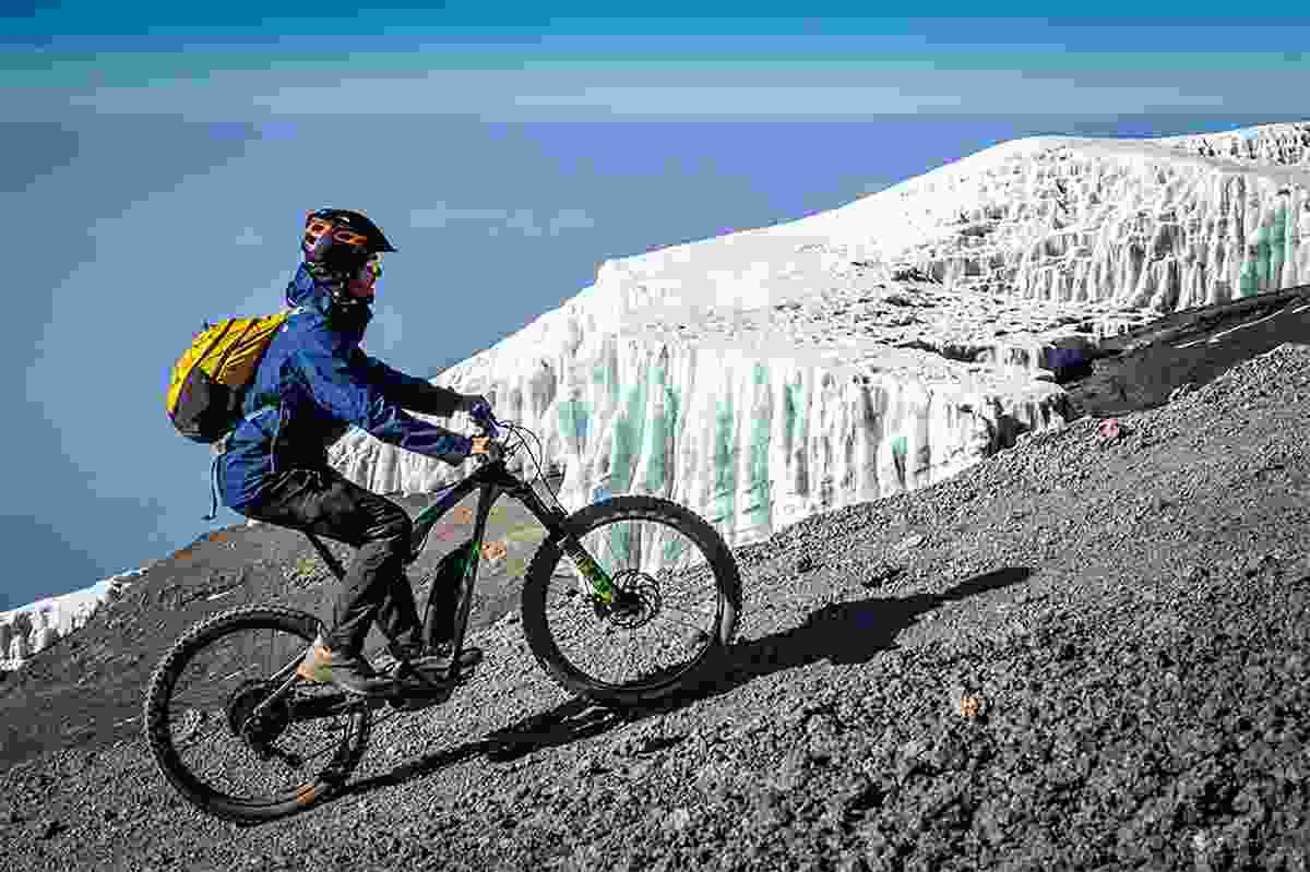 With the e-Bike on almost 6000 meters at Kilimanjaro in Africa (Photo © Adrian Rohnfelder. All rights reserved)