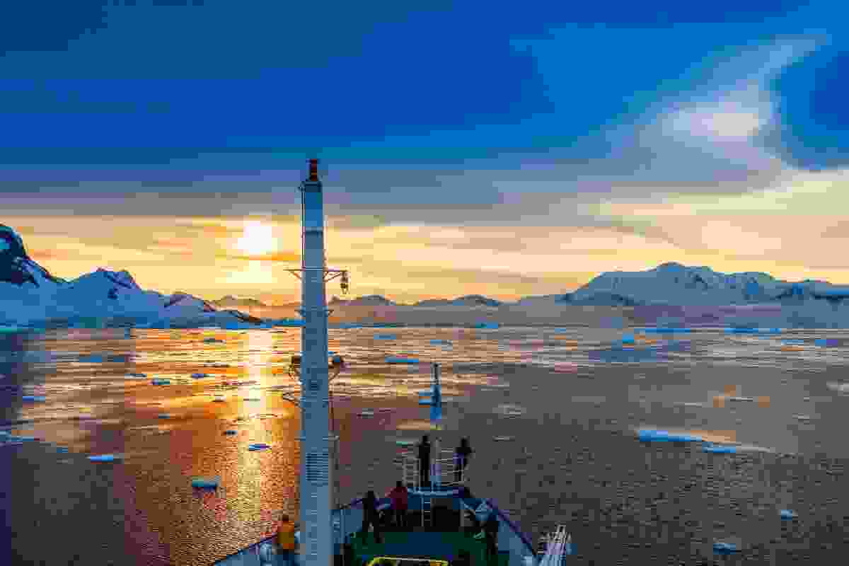 Looking out across the Antarctic sunset from the deck (Dreamstime)
