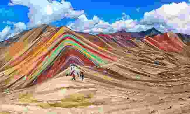 Tourists walking on the Rainbow Mountain (Shutterstock)