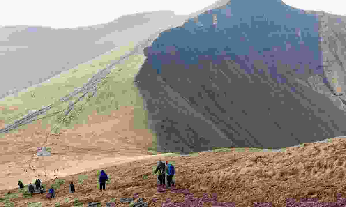 Hikers approaching Summit of Pen y Fan (Shutterstock)