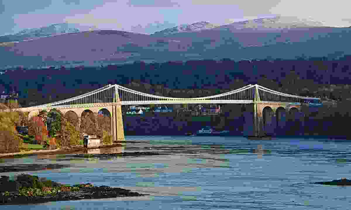The Menai Suspension Bridge and Mountains from A5 Layby, Anglesey (Shutterstock)