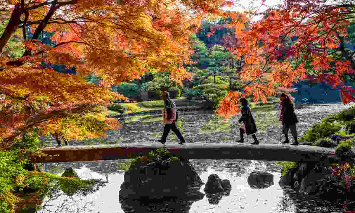 Crossing a stone bridge in Rikugien Garden (Shutterstock)