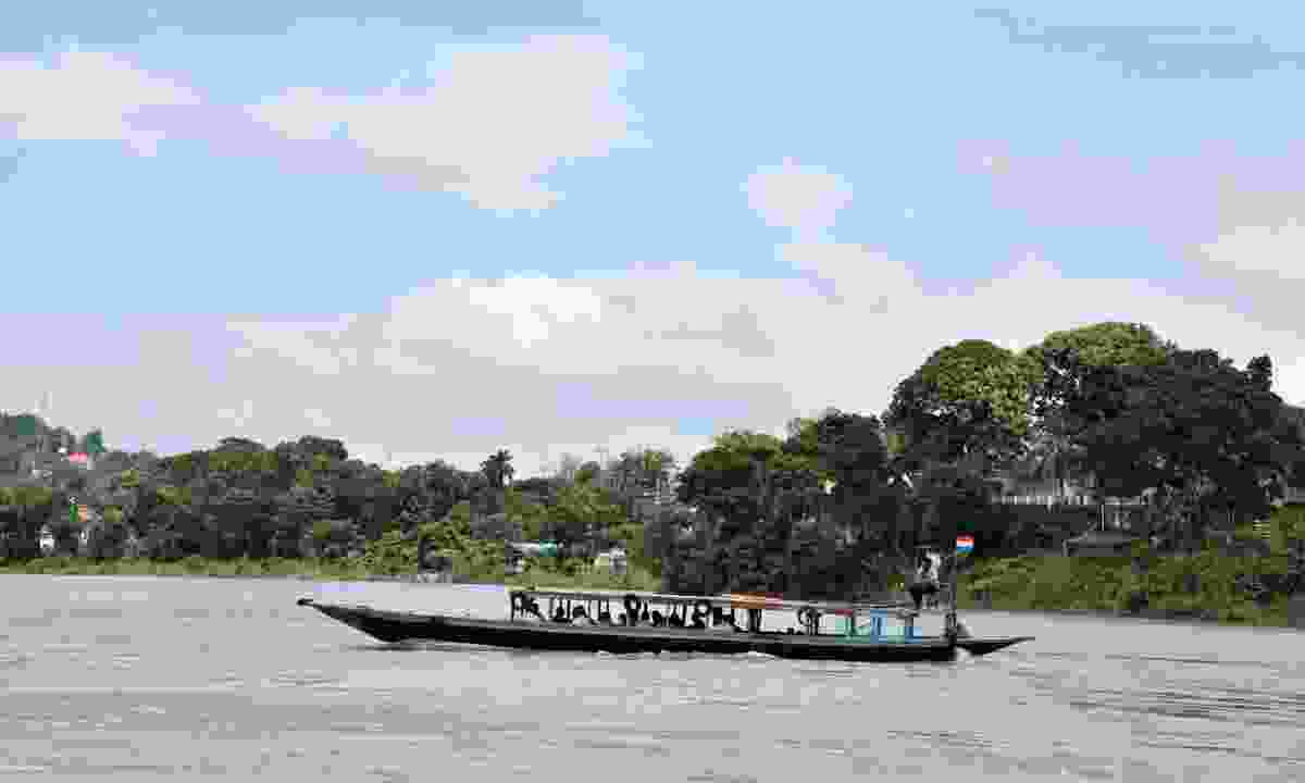 Explore by boat along the Brahmaputra river (Dreamstime)