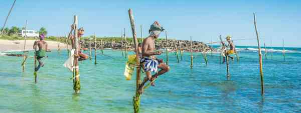 Traditional fishermen in Sri Lanka (Dreamstime)
