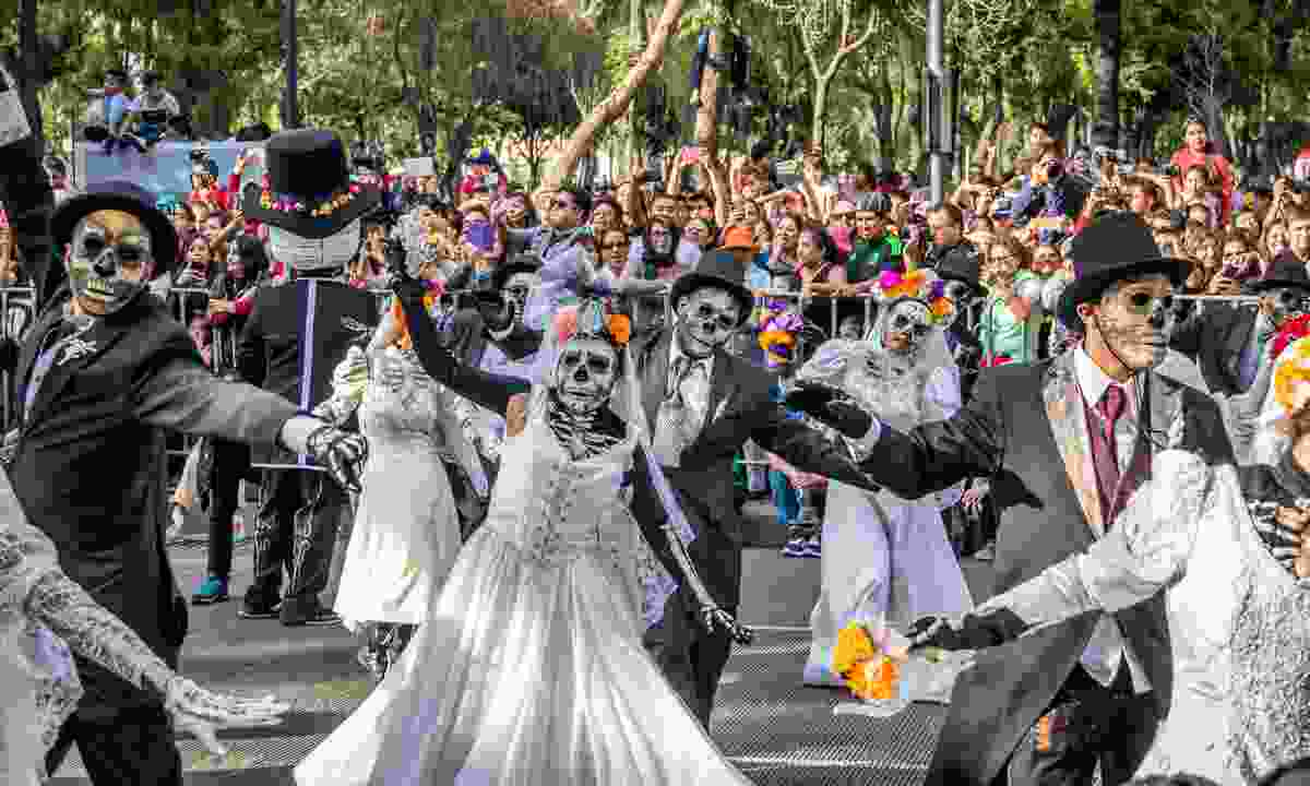 People parading through Mexico City's streets (Dreamstime)