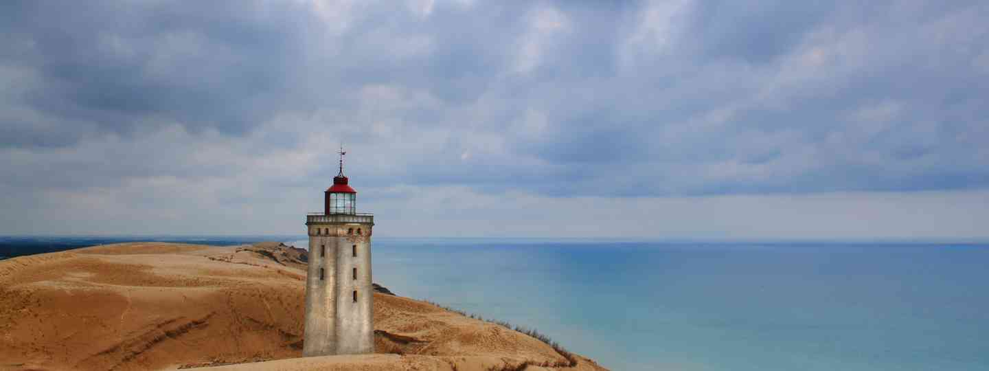 Main image: Rubjerg Knude Lighthouse in Denmark (Dreamstime)