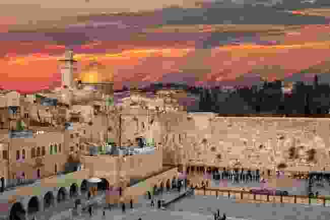 Praying at the Western Wall (Shutterstock)