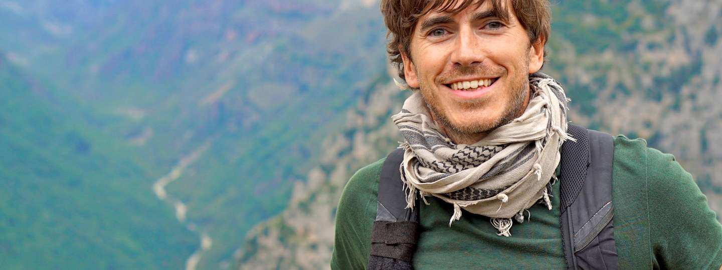 Simon Reeve at Vikos Gorge – the deepest gorge in the world (BBC/Olly Bottle)