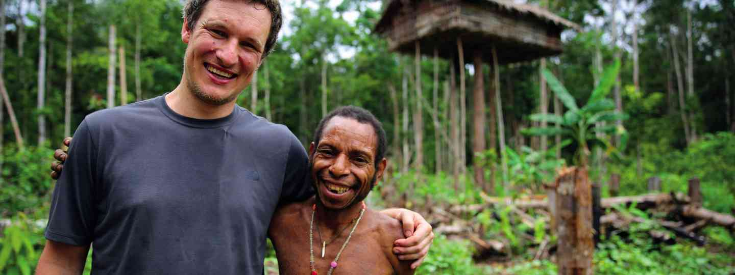 Will Millard with a member of the Korowai tribe (BBC/ KEO Films, Gavin Searle)