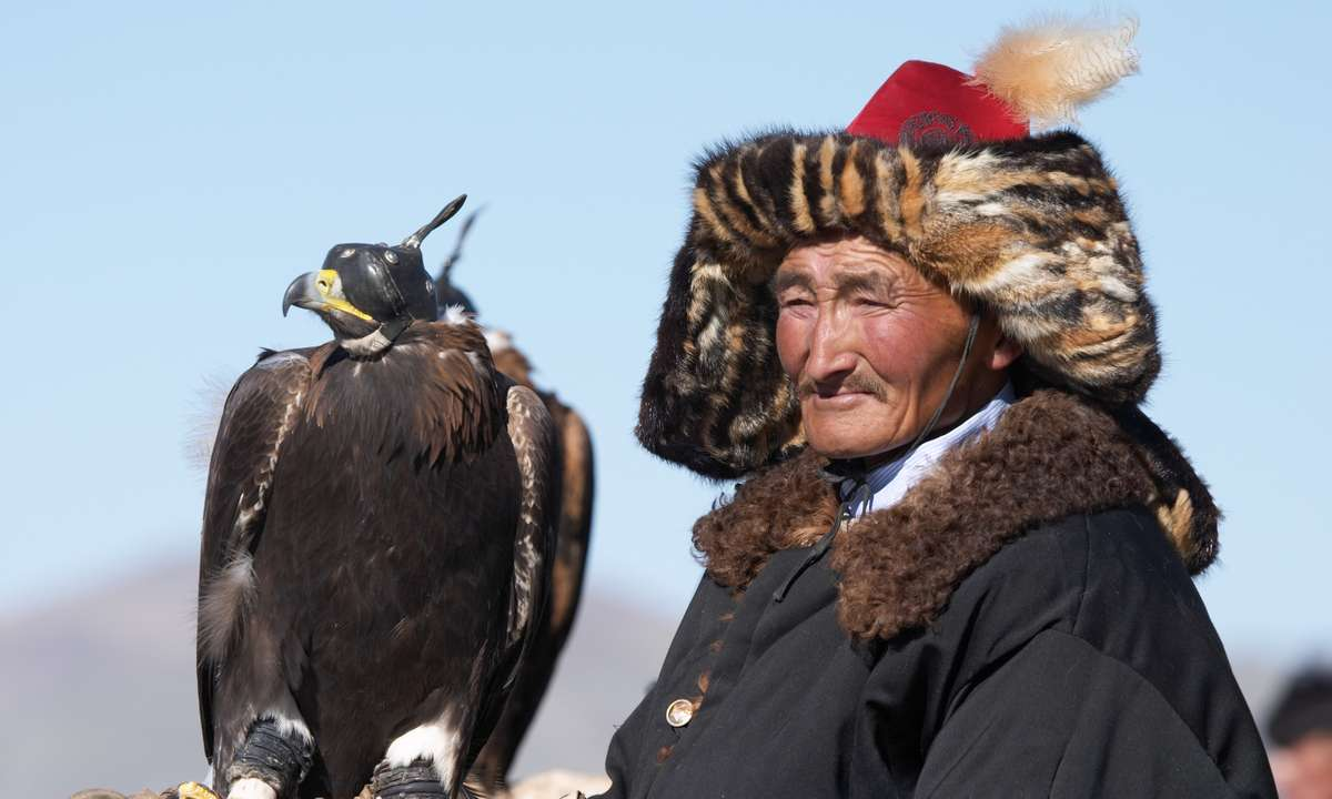 An eaglehunter with his eagle (Dreamstime)
