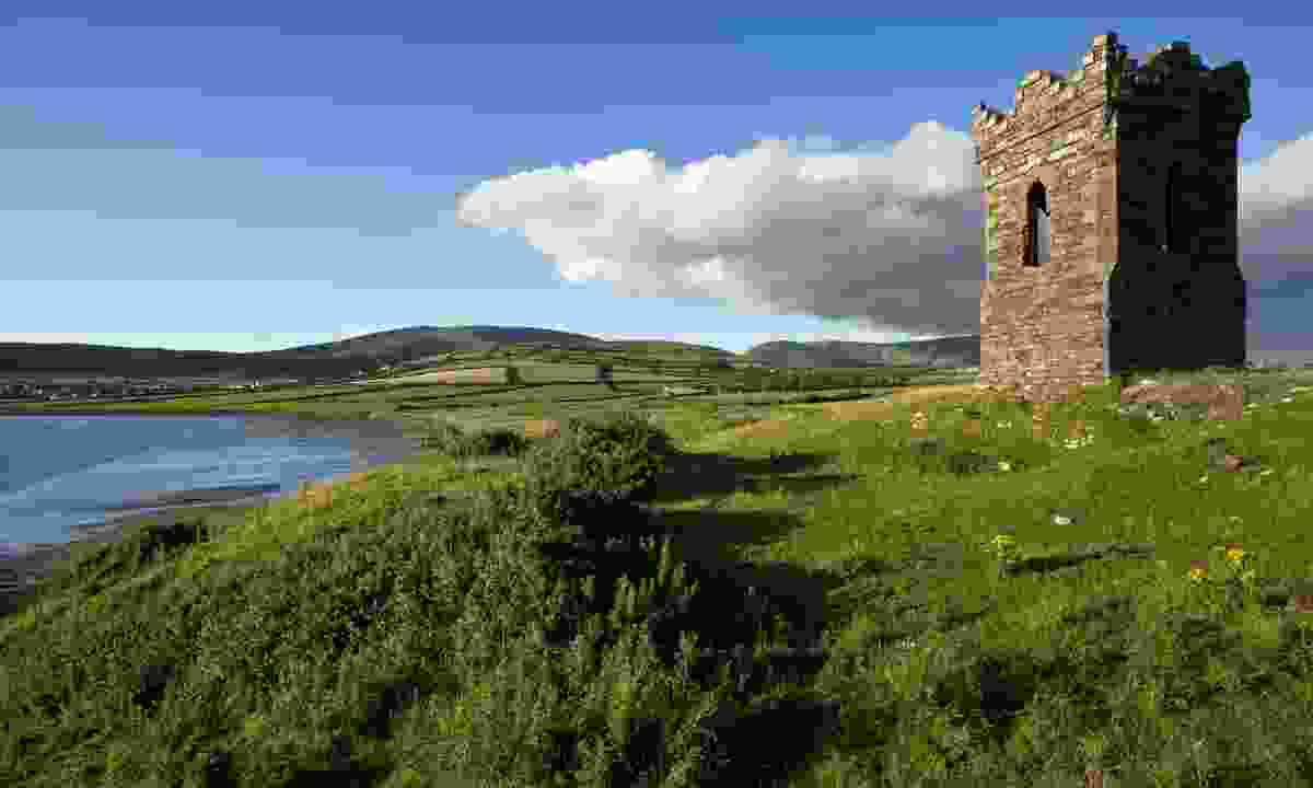 An old stone watch tower over looking Dingle Bay (Dreamstime)