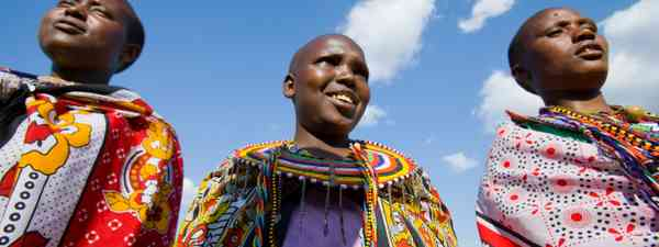 Masai girls wearing kangas (Dreamstime)